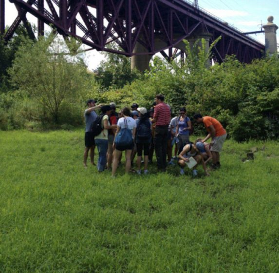 The author leading a field trip in an urban wetland. Photo by Hara Woltz.