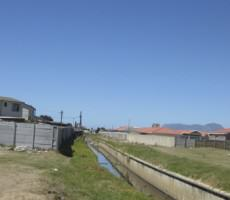 Cape Town's rivers canalized historically to address flooding issues in the developing City are now significantly ecologically degraded, victims of dumping, and socially shunned as sites of criminal activity. Photo: Pippin Anderson
