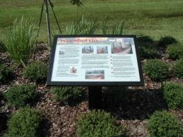 A sign along a sidewalk in the Town of Harmony, FL that describes the benefits of prescribed fire to residents; this sign was necessary in order to inform residents and promote acceptance of prescribed burns near the community. Photo by Mark Hostetler