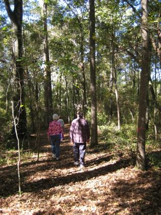 Residents enjoying a stroll through a wooded remnant in a development. Staying on trails is an important action by residents to minimize impacts on local plant and animal communities.  Photo by Mark Hostetler.