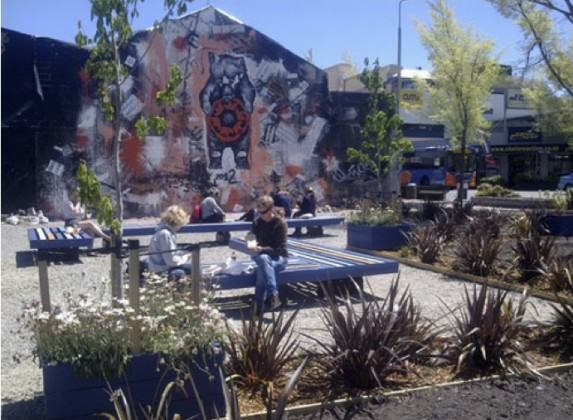 Tess' mural, the stage and seats in use - the park is finished! http://greeningtherubble.org.nz