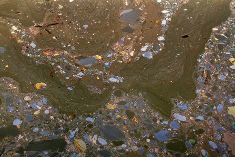 The polluted surface of the Gowanus Canal. Photo: William Miller http://www.psfk.com/2013/03/gowanus-canal-pollution-photos.html