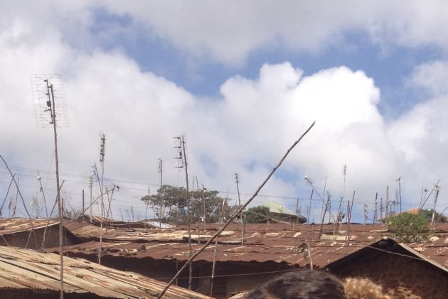 Antennae and power lines above roofs in Kibera, Nairobi. PhotoL Andrew Rudd