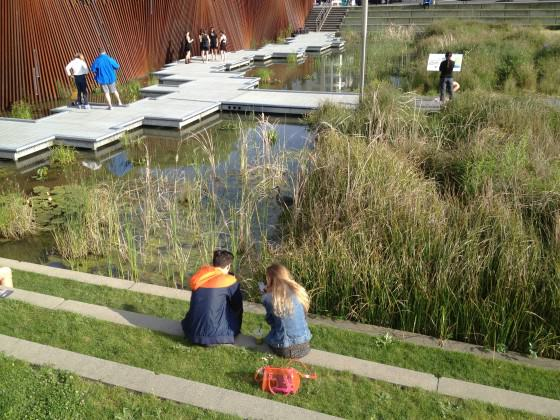 Visitors with Great Blue Heron, Tanner Springs Park. Photo: Mike Houck