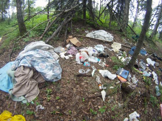 "Trash at illegal campsites scattered through Anchorage adds to the city's ""garbage bear"" problems. Photo: Wayne Hall"