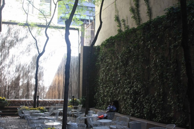 A small park in Midtown Manhattan (53rd St), with a waterfall and a green wall. Green walls may reduce up to 40dB of outdoor noise and vibration. Photo: David Maddox