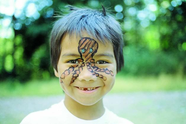 Face-painting at a CRD interpretive event.  Photo: CRD Image Library.