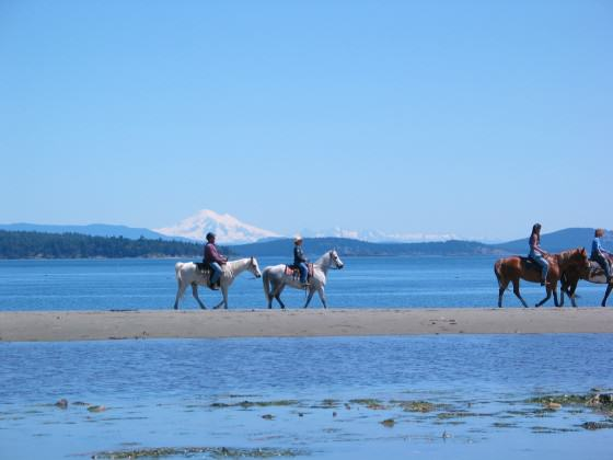 Horseback riding at Island View Beach Regional Park.  Photo CRD Image Library.