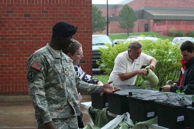 Fort Drum army soldiers and wives participating in a distance-gardening activity, coordinated by members of Cornell's Civic Ecology Lab and Jefferson County Cornell Cooperative Extension.