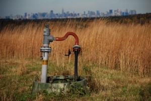 New York City's capped Fresh Kills Landfill with the Manhattan skyline in the distance. Photo: Nathan Kensinger