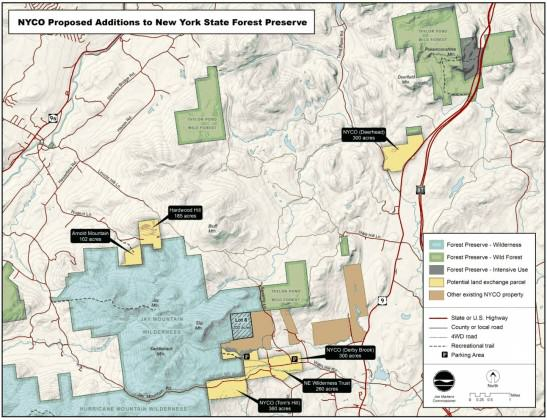 Map showing existing NYCO wollastonite mines (brown), 1 km2 mine expansion as the hatched area cutting into the Jay Mountain Wilderness (blue) and 7 km2 land swap (yellow). Obtained at http://www.adirondackalmanack.com/