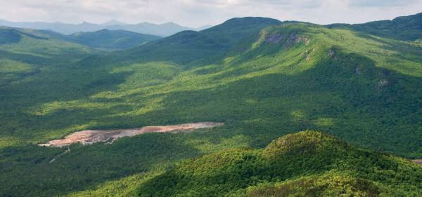 Existing wollastonite mine (foreground) will now expand 1 km2 into the Jay Mountain Wilderness (background), which until the successful November amendment was protected by the New York State Constitution. Photo: Carl Heilman II