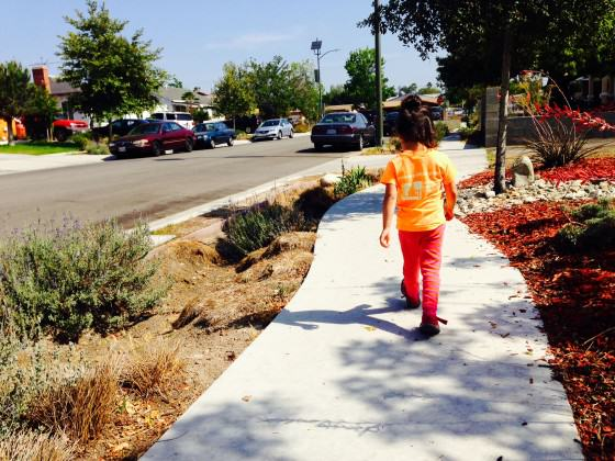3-year old walking on Elmer Avenue, a green street pilot project in Sunland, CA