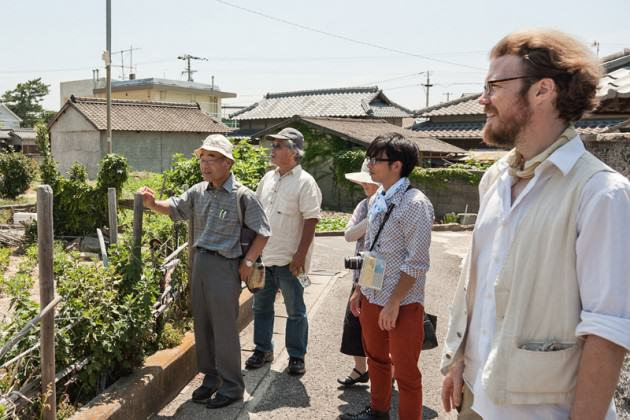 A 'state of agriculture' walking tour of Megijima which our team arranged with natural farmers from around Japan. Photo: Suhee Kang