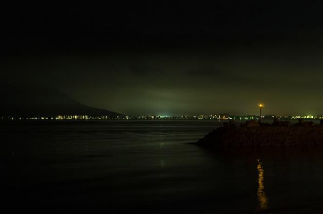 The glow of Takamatsu, a short twenty-minute ferry ride from Megijima. Photo: Patrick M. Lydon