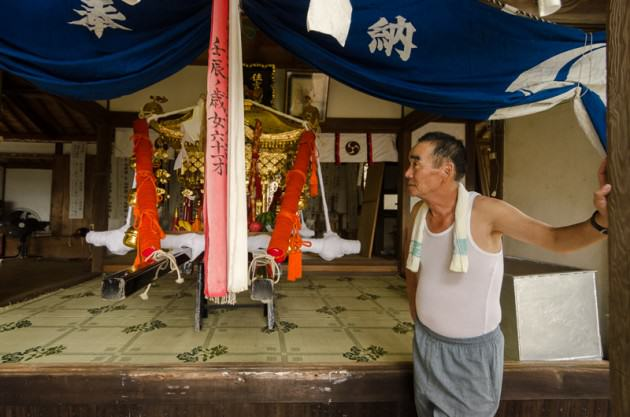 One of the town elders watching over the temple before the Matsuri festival. Photo: Patrick M. Lydon