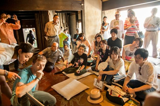 Programmer Johann Barbie, showing our work to locals during a regional sustainable farming symposium which we initiated as artists in Megijima, Japan. Photo: Patrick Lydon