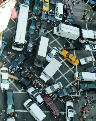 New York City gridlock with pedestrians. Credit.
