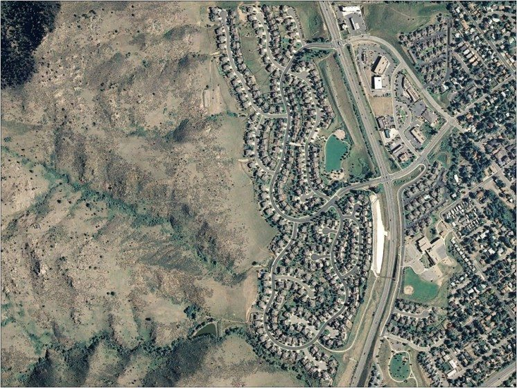 Aerial photo of development in the foothills of Colorado. Nearby development can have significant impacts on the biological integrity of natural areas. Photo: Sarah Reed