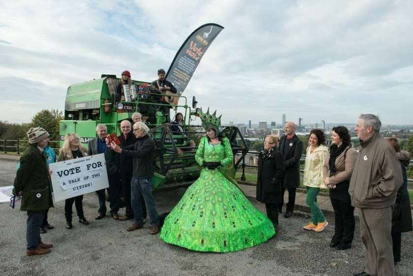 Two green goddesses meet in Everton Park serenaded by Ian Prowse to launch the Tale of Two Cities Campaign in October 2014