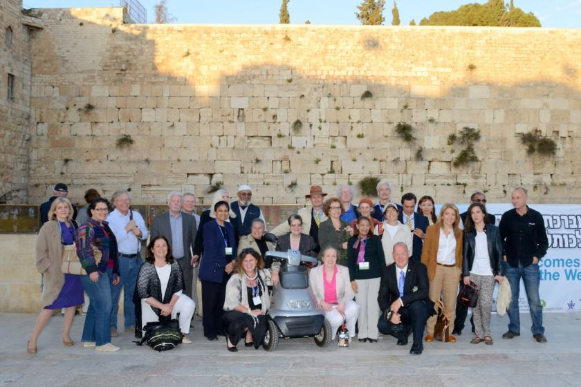 The above picture was taken at the closing ceremony of the International Jerusalem Symposium on Green and Accessible Pilgrimage. At the event we welcomed the swifts, who are only a few of half a billion birds that fly over Jerusalem twice a year on their migration route, following the Afro-Syrian Rift Valle. They stop over in Jerusalem for mating, rest and recreation. 88 pairs of swifts nest in ancient crevices in the Western wall, and the picture below this shows a closer view of a swift about to enter its nest. They seem to be keen on interfaith pilgrimage, since some of our swifts prefer to pray at the Church of the Holy Sepulchre, while others pray in the Great Mosque.