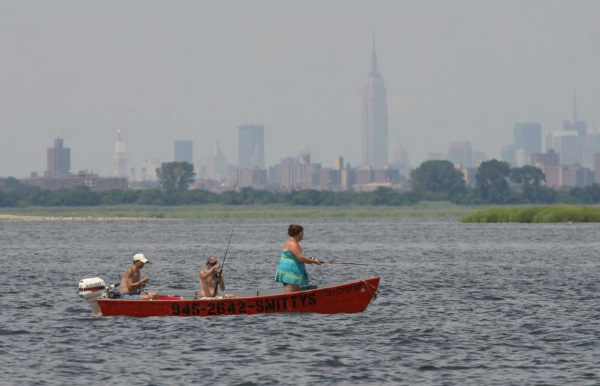 Fishing in Jamaica Bay, with New York skyline. Photo: Don Riepe, American Littoral Society