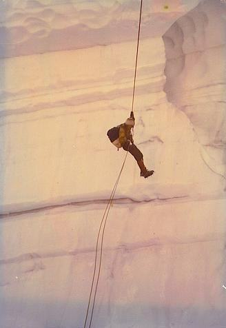 The author rappelling into a crevasse in the Glacier Peak Wilderness Area. Courtesy of Marianne Krasny.