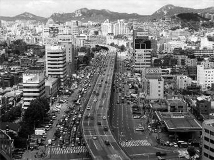 Cheonggyecheon stream in Seoul, with a highway running over it.