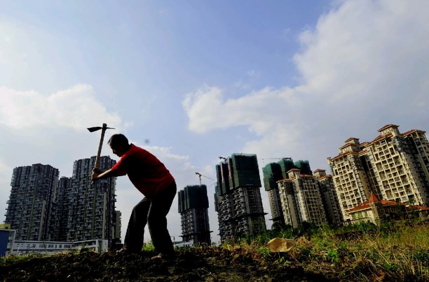 "Urban development encroaching upon farmland (Source: China Economy Net ""Economic Daily"" 中国经济网—《经济日报》)"