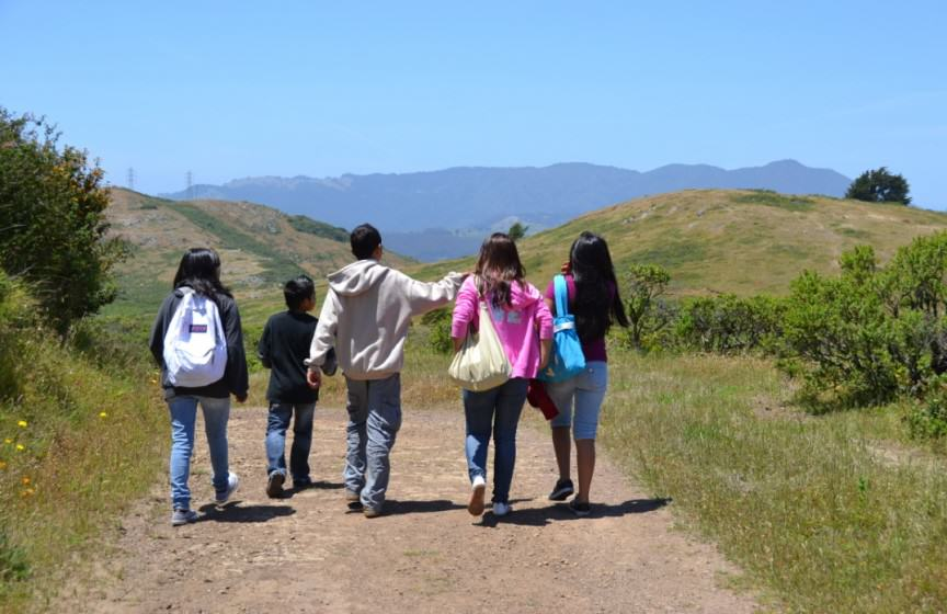 Image 15 - photo of five children hiking along a road