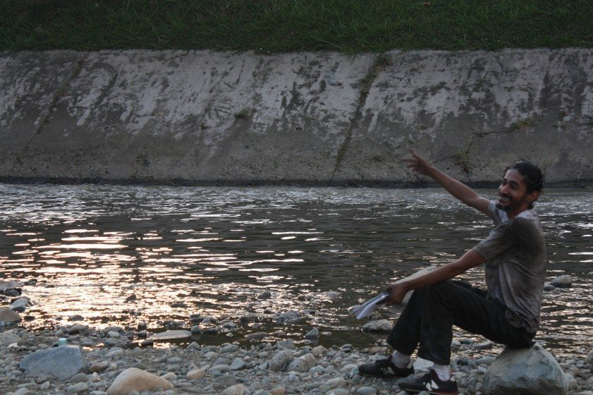 Homeless person, Medellin River. Photo: Claudio Valcamonico