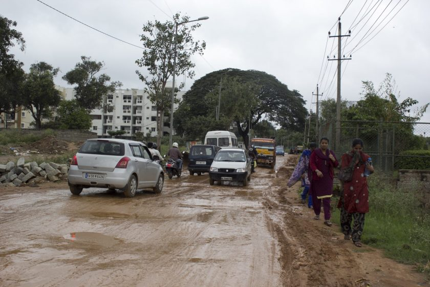 Pedestrians and commuters negotiate their ways to work on a wintry December morning in North Bangalore