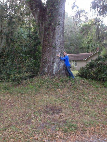 JB hugging a tree