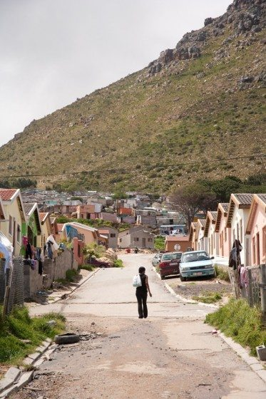 A woman walking along a street in the informal settlement or so-called township of Imizamo Yethu in the Cape Town suburb of Hout Bay.