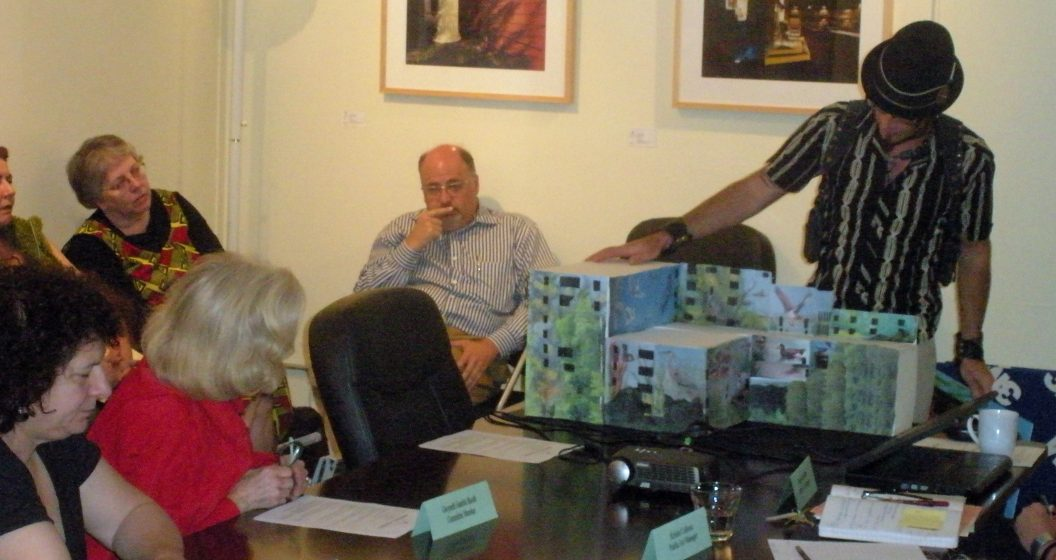 Image 8 Dan Cohen at RACC mural committee with Houck model Photo Mike Houck