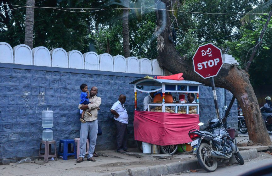 Roadside snack sellers—in this case a chaat shop—conduct brisk business next to a street tree. Photo credit: Suri Venkatachalam
