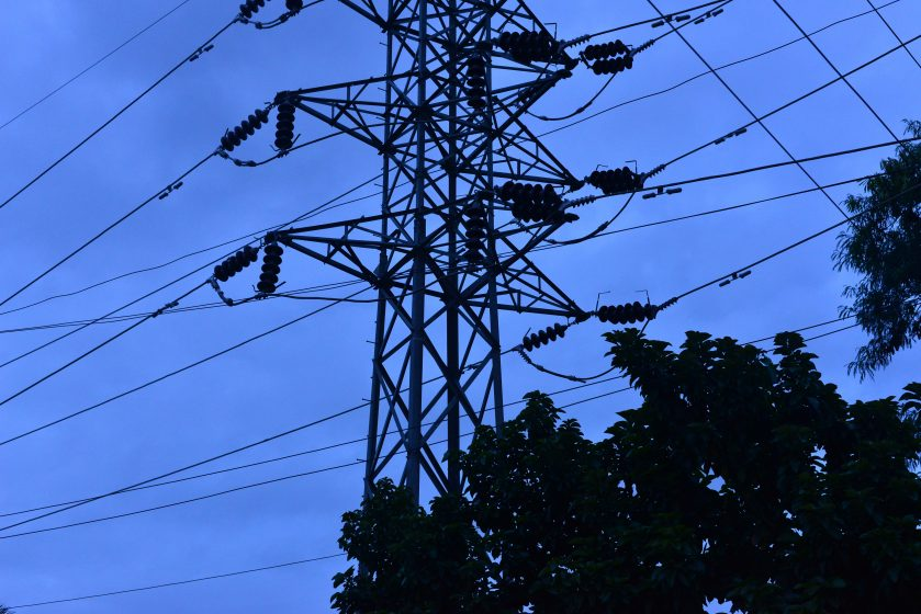 Meeting Bangalore's growing needs for energy, an electricity transformer towers over the trees cape. Photo credit: Suri Venkatachalam