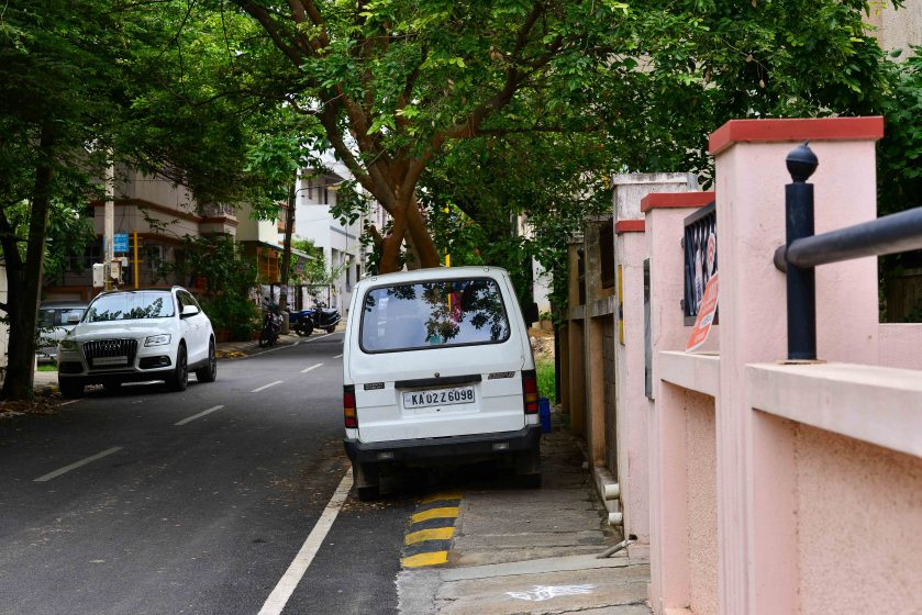 Many small homes lack space for a garage. Instead, cars are parked outside in a shady spot. Street trees are much valued in these neighborhoods. Photo credit: Suri Venkatachalam