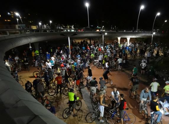 Thousands of cyclists gather under a full moon at Green Point in Cape Town, before cycling in mass through the city. Photo: Russell Galt