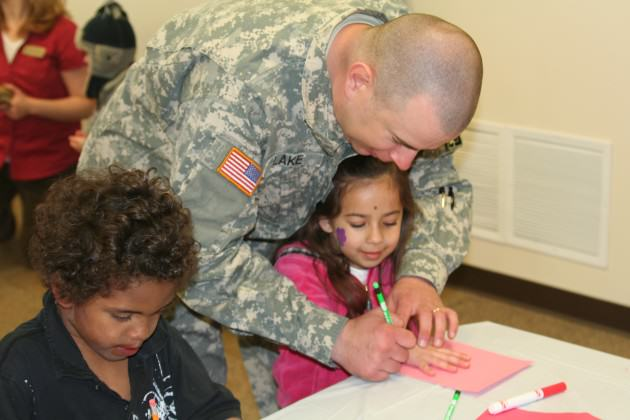 soldier w daughter drawing hand