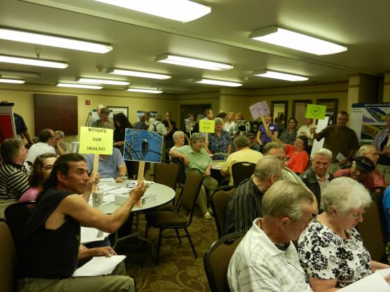 Manufactured Home Community Protesting Development in 2012. David Redthunder in foreground holding picture of eagle. Photo: Bob Sallinger
