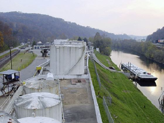 Freedom Industries site on the Elk River where the chemical spill occurred. The intake for West Virginia American Water, which supplies water to 300,000 people in the Charleston area, is 1.2 km downstream, in the distant upper left. Photo obtained at http://inhabitat.com/huge-chemical-spill-leaves-30000-without-drinking-water-in-west-virginia/