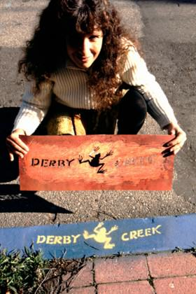 Urban Ecology member Nancy Lieblich stenciling storm drains in Berkeley in 1989. Photo courtesy of Richard Register