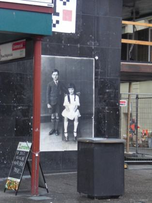 Illegal guerilla poster posting by Peter Drew, Adelaide CBD. Image is of a series old photograph of Adelaidians from the past that Peter unearther for the project. Photo: Paul Downton